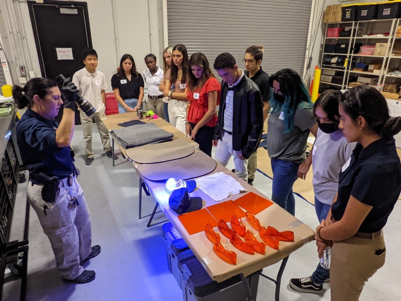 Teen Academy students watch a science demonstration.