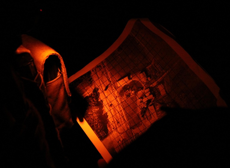 Hostage Rescue Team operators consult a map during a night exercise.