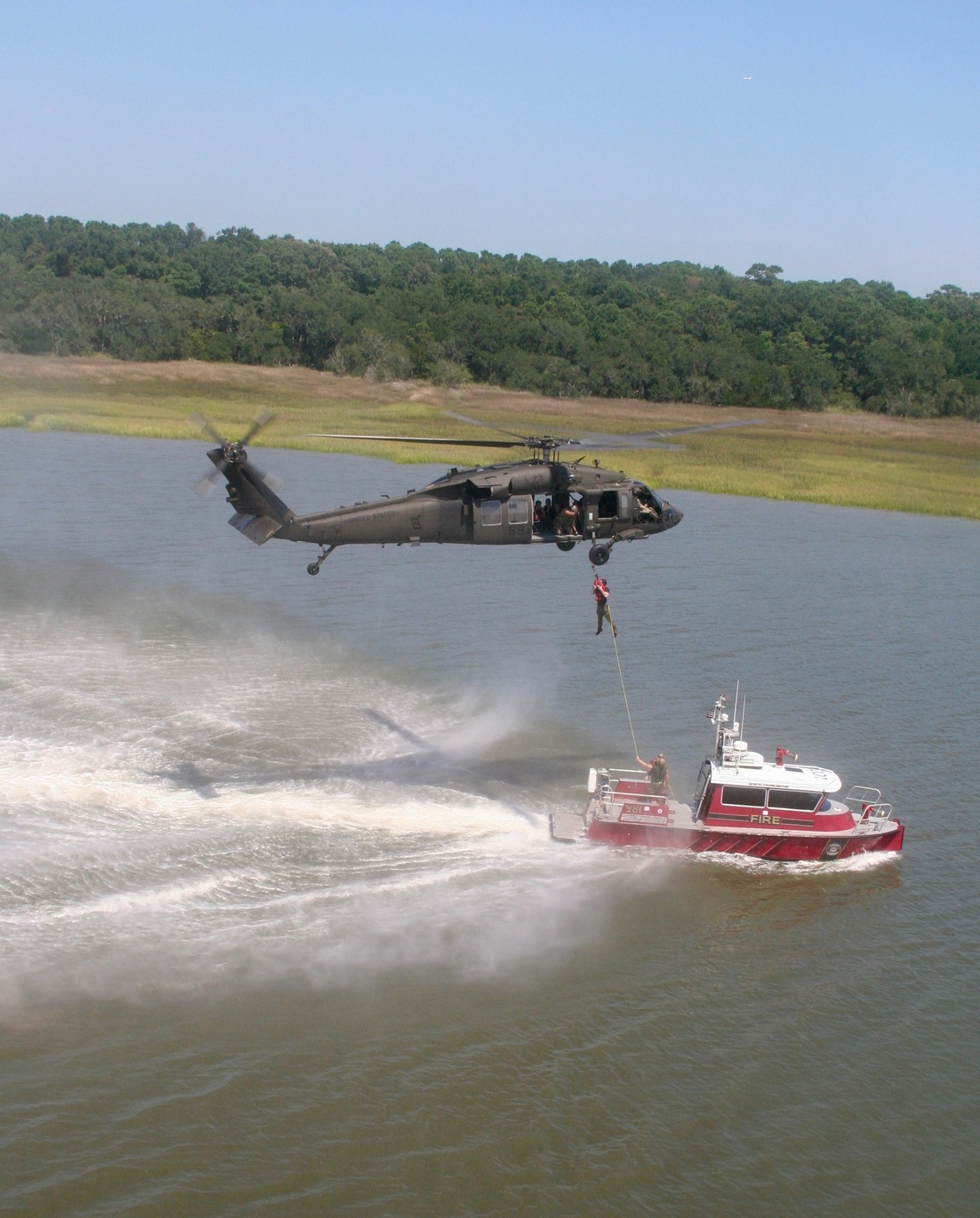 An FBI helicopter lifts firefighters from a fireboat during a Hostage Rescue Team (HRT) training exercise held August 5-7, 2019, in Charleston, South Carolina.