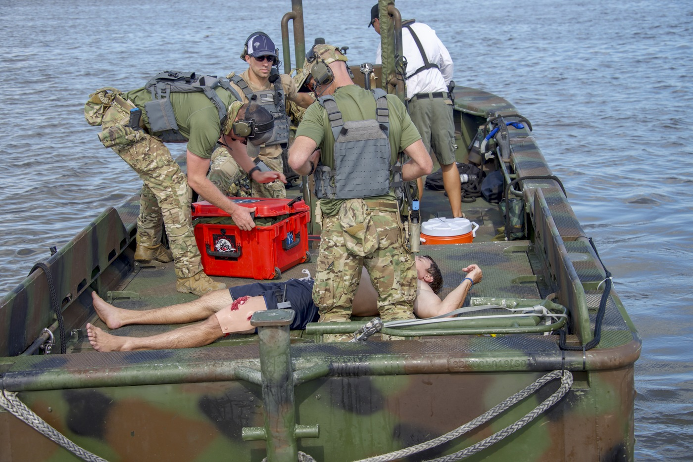 "Trainees with the Hostage Rescue Team attend to an ""injured"" boater during a Hostage Rescue Team (HRT) training exercise held August 5-7, 2019, in Charleston, South Carolina."