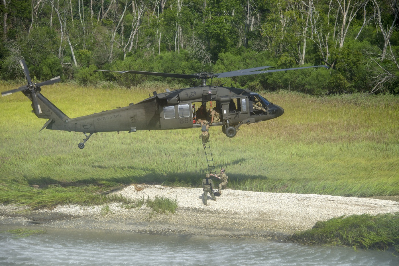 Photo of FBI agents using a rope ladder to climb into a hovering Black Hawk helicopter during a Hostage Rescue Team (HRT) training exercise held August 5-7, 2019, in Charleston, South Carolina.