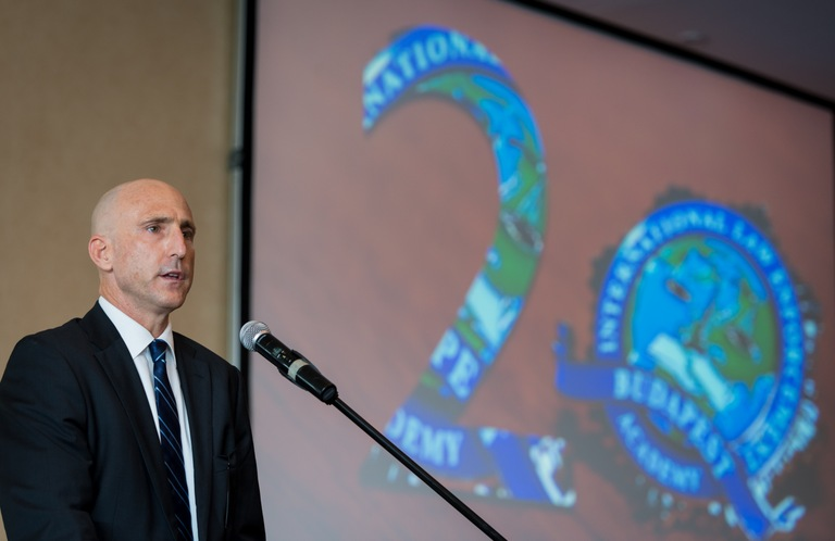 FBI Special Agent John Terpinas, director of the International Law Enforcement Training Academy (ILEA) in Budapest, Hungary, speaks at a July 17, 2015 event there celebrating the organization's 20th anniversary and the graduation of its 100th core class.
