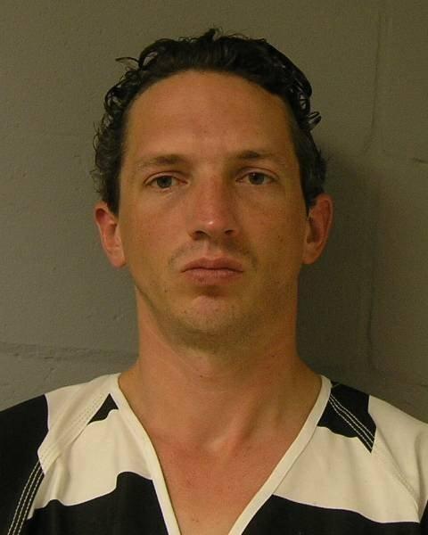 Mugshot of Israel Keyes in black and white prison garb