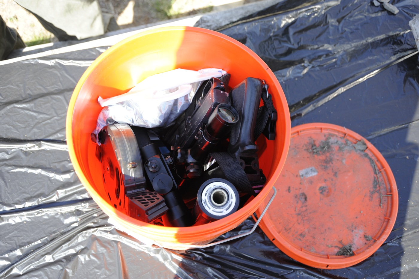 Keyes' cache in New York was stowed in a watertight bucket. Materials inside included a .22-caliber Ruger weapon without a stock, empty magazines, ammunition, and a silencer.
