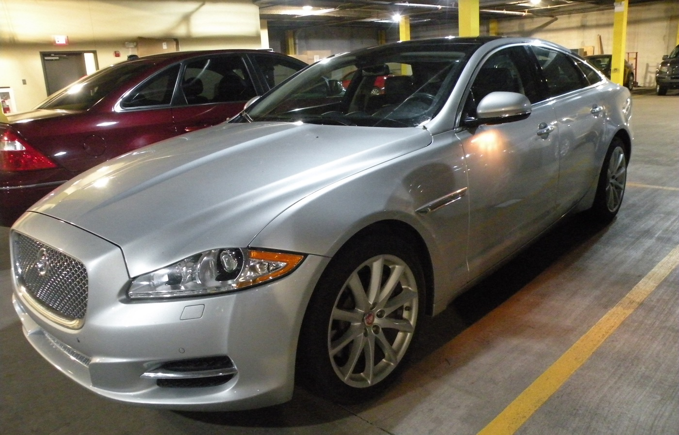 Silver luxury vehicle in parking garage; vehicle was forfeited in Jackie Garton fraud case (Memphis Field Office)