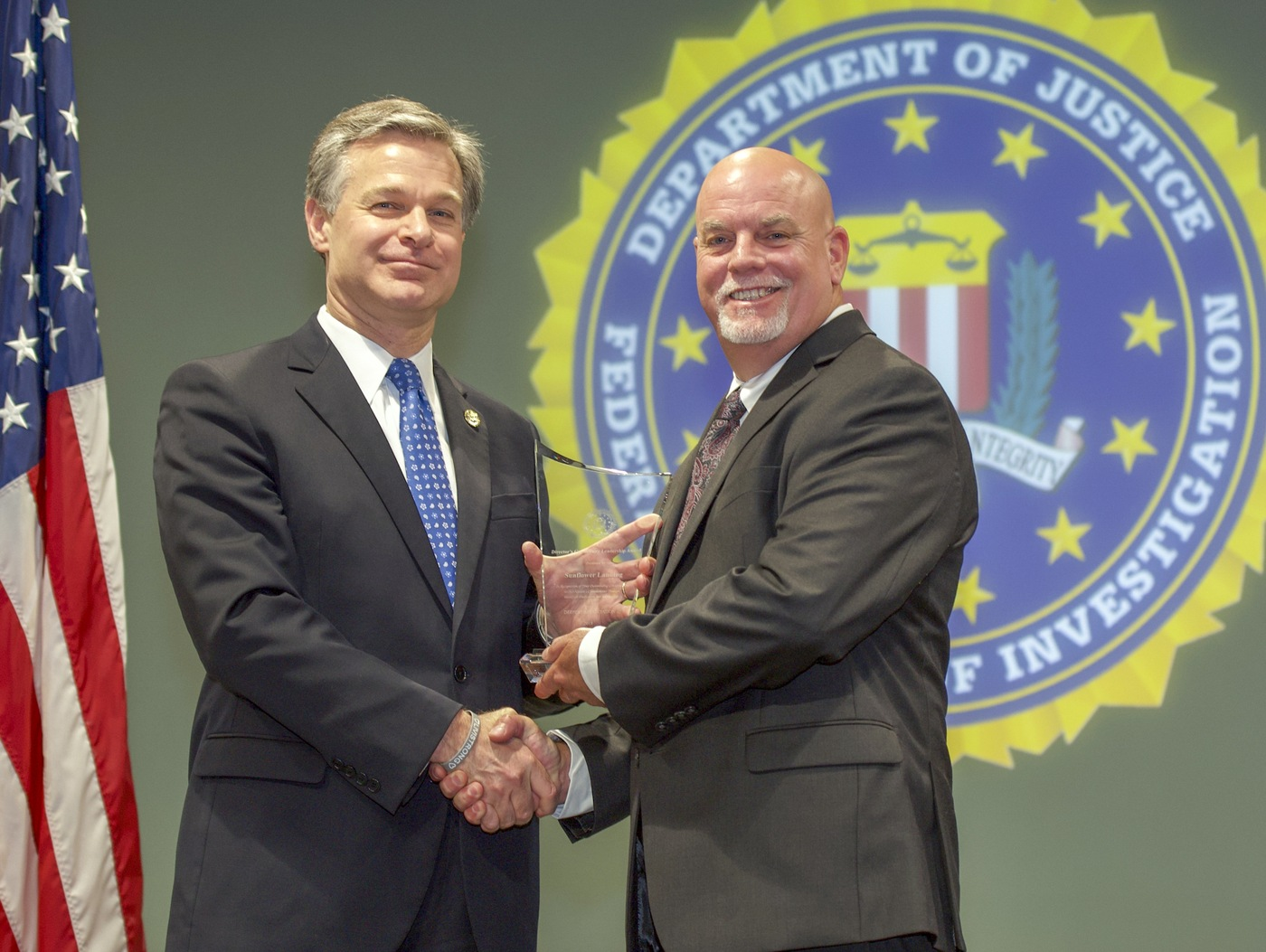 FBI Director Christopher Wray presents Jackson Division recipient Sunflower Landing (represented by Shane Garrard) with the Director's Community Leadership Award (DCLA) at a ceremony at FBI Headquarters on May 3, 2019.