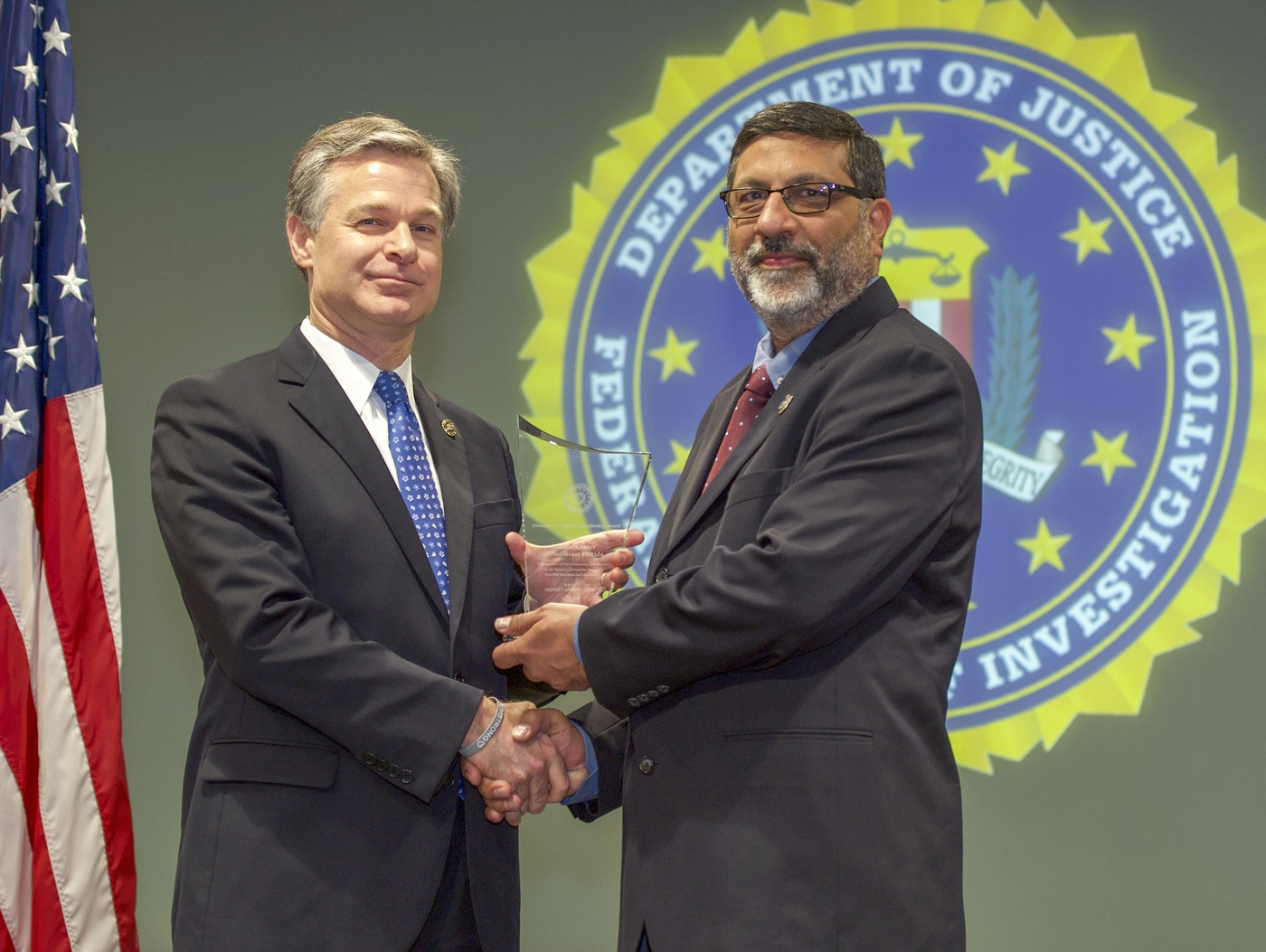 FBI Director Christopher Wray presents Jacksonville Division recipient the Islamic Center of Northeast Florida (represented by Shauib Karim) with the Director's Community Leadership Award (DCLA) at a ceremony at FBI Headquarters on May 3, 2019.