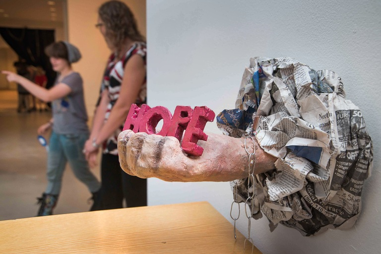 "Student artwork on display at the ""Human Trafficking: Do You See It?"" exhibit hosted by the Northeast Florida Human Trafficking Coalition. Some artwork at the exhibit focuses on the positive potentials that can come from an extremely negative situation."