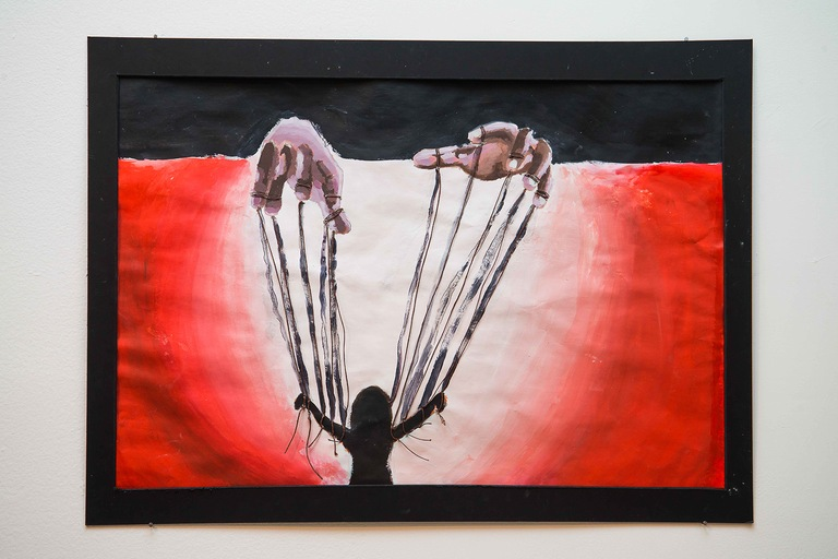 "Student artwork on display at the ""Human Trafficking: Do You See It?"" exhibit hosted by the Northeast Florida Human Trafficking Coalition. Student artwork in a variety of styles depicts various facets of human trafficking."