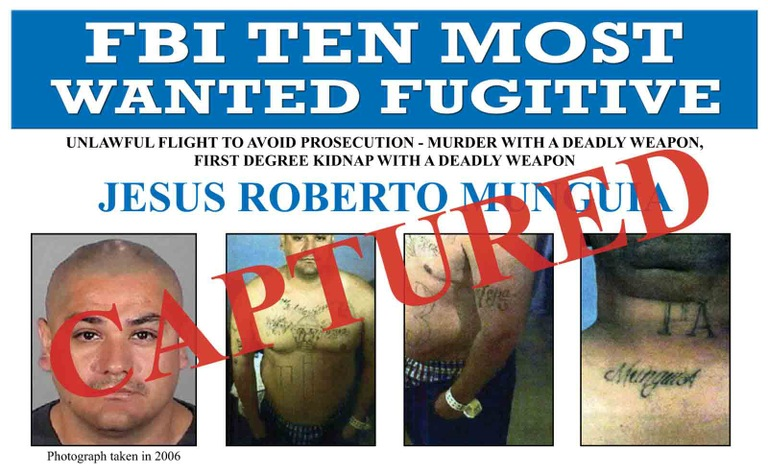 A cropped version of the Ten Most Wanted Fugitive poster of Jesus Roberto Munguia with Captured banner.
