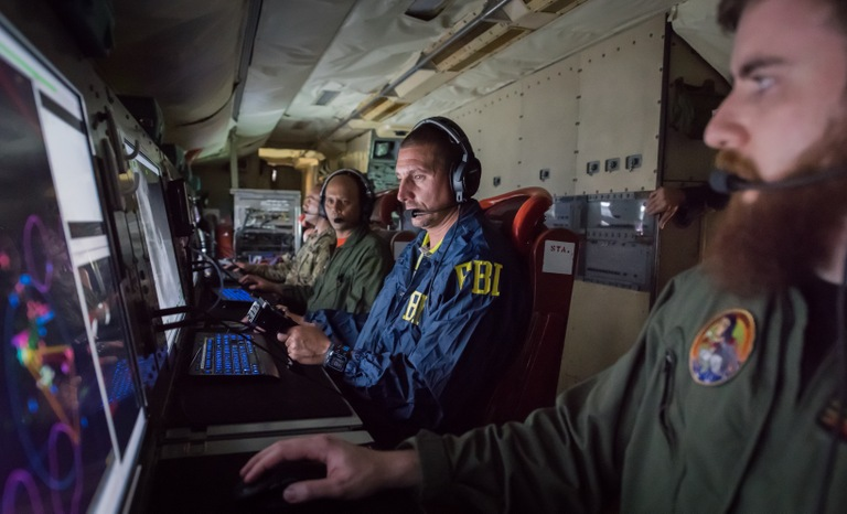 Joint Interagency Task Force South (JIATF-S) personnel operate aboard a U.S. Navy plane to track drug traffickers.