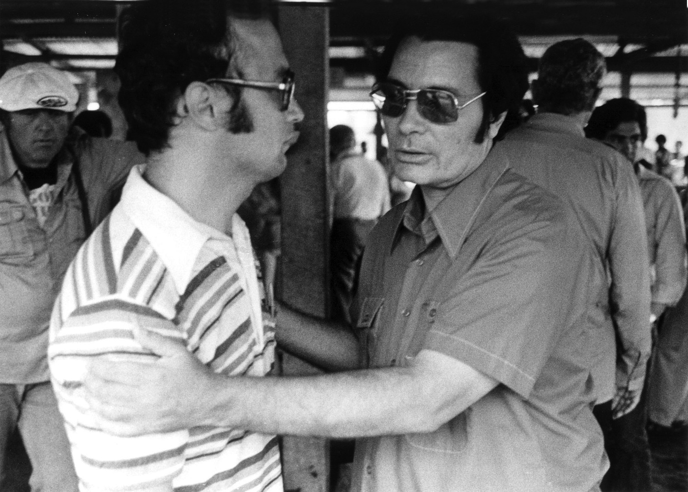 Jim Jones, right, with an unidentified man at Jonestown on November 18, 1978. Shortly after taking the picture, the photographer was killed during the ambush at the airport. AP Photo.