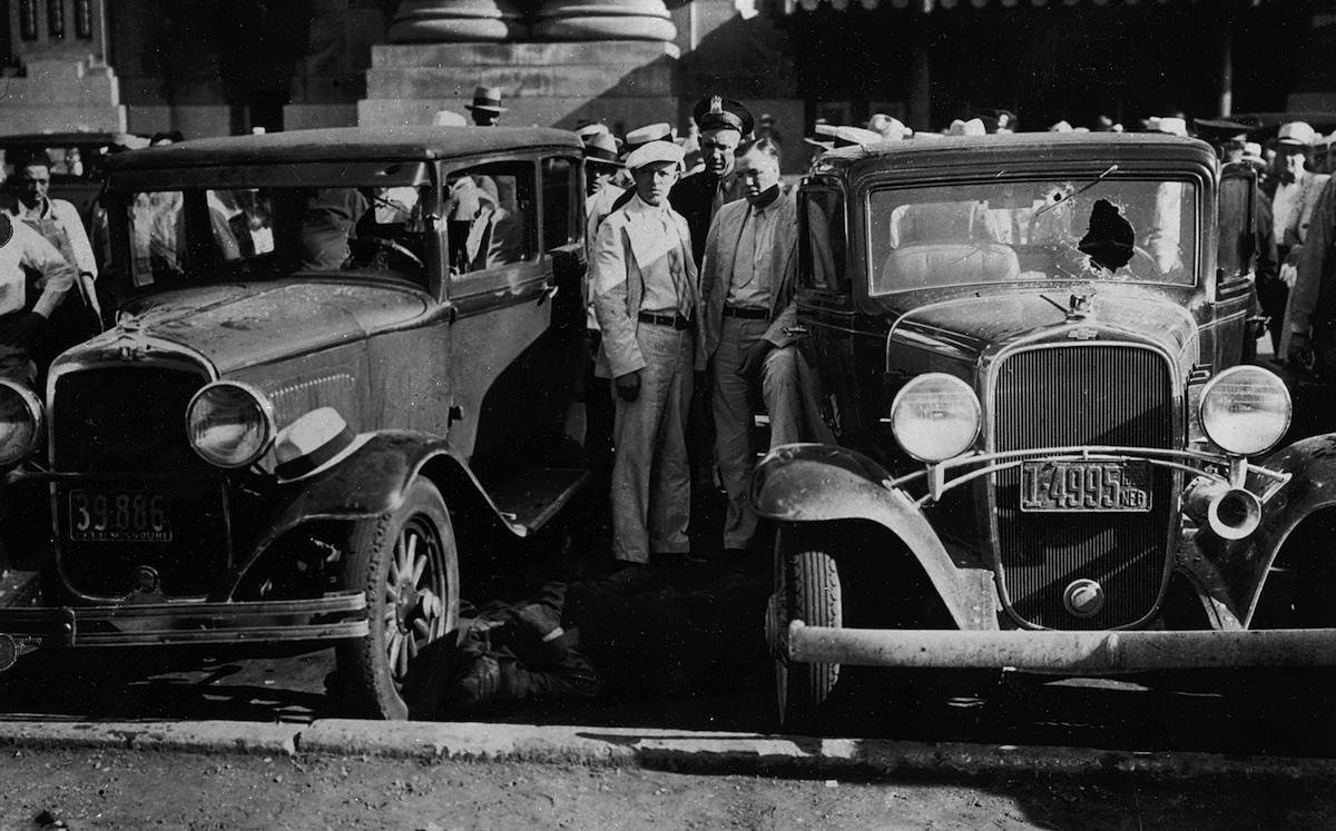 Scene in front of the Kansas City railroad depot on June 17, 1933 moments after the ambush to free prisoner Frank Nash from his law enforcement handlers, known as the Kansas City massacre.