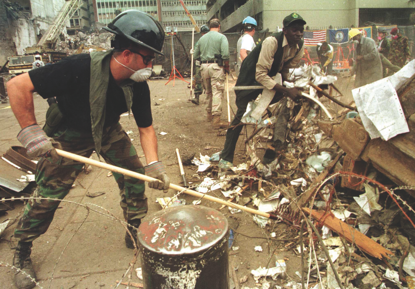 An FBI agent rakes through debris looking for clues following the car bombing of the U.S. Embassy in Kenya in August 1998. Reuters.