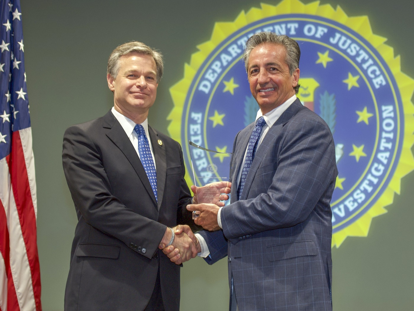 FBI Director Christopher Wray presents Las Vegas Division recipient Tony Bonnici with the Director's Community Leadership Award (DCLA) at a ceremony at FBI Headquarters on May 3, 2019.