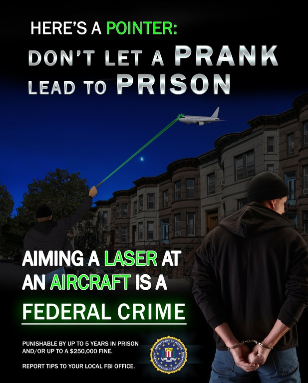 Poster depicting urban environment with the message: Don't Let a Prank Lead to Prison. Aiming a laser at an aircraft is a federal crime.