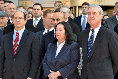 Former FBI Director Robert Mueller, seen with Robert Levinson's wife Christine and former FBI Deputy Director Sean Joyce during a 2012 press conference, announced a $1 million reward in the Robert Levinson case.