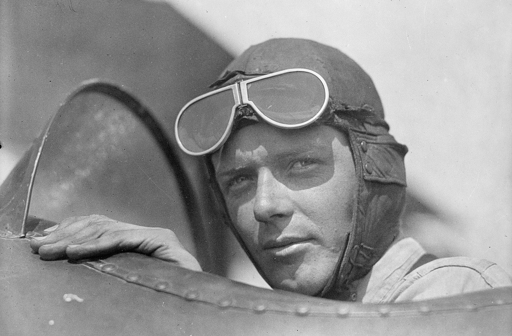 Charles Lindbergh, wearing helmet with goggles up, in open cockpit of airplane at Lambert Field, St. Louis, Missouri, in 1923. Library of Congress.