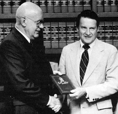 Lou Peters, left, receives an award from FBI Director William Webster in 1980.