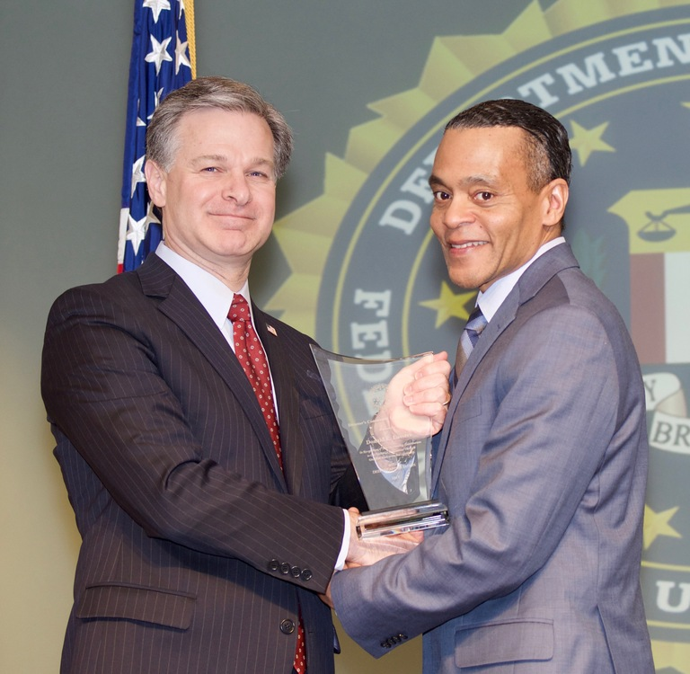 FBI Director Christopher Wray presents Louisville Division recipient Donald E. Lassere with the Director's Community Leadership Award (DCLA) at a ceremony at FBI Headquarters on April 20, 2018.
