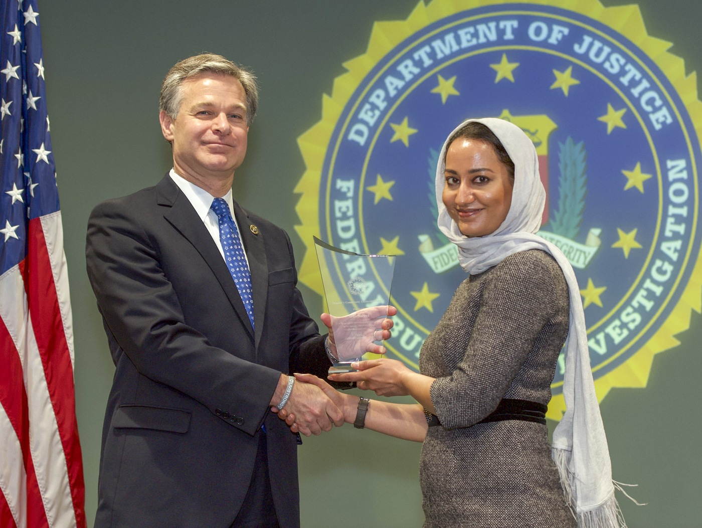 FBI Director Christopher Wray presents Louisville Division recipient Soha Saiyed with the Director's Community Leadership Award (DCLA) at a ceremony at FBI Headquarters on May 3, 2019.