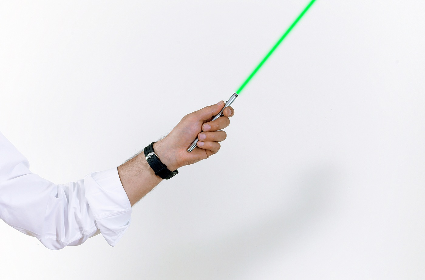 Stock image depicting person holding laser pointer.