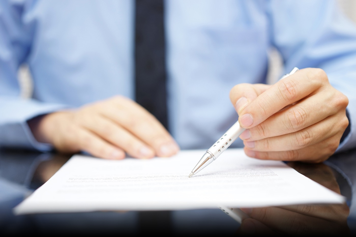 Man with Pen and Document (Stock Image)