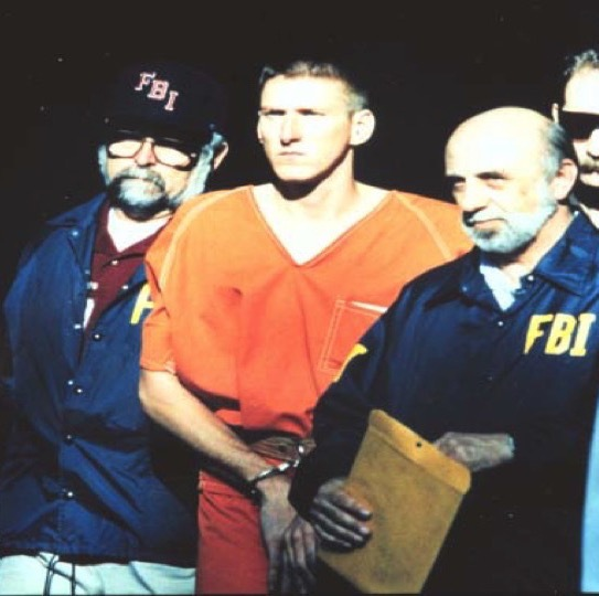 Flanked by FBI agents—including Jim Norman, left—Timothy McVeigh is taken into federal custody.
