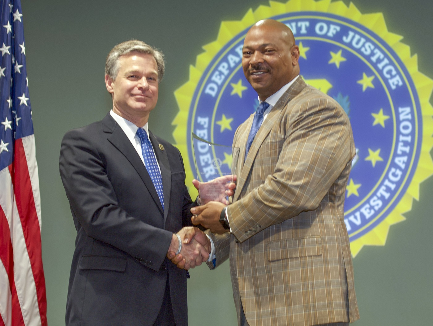 FBI Director Christopher Wray presents Memphis Division recipient Dismas House (represented by Gerald Brown) with the Director's Community Leadership Award (DCLA) at a ceremony at FBI Headquarters on May 3, 2019.