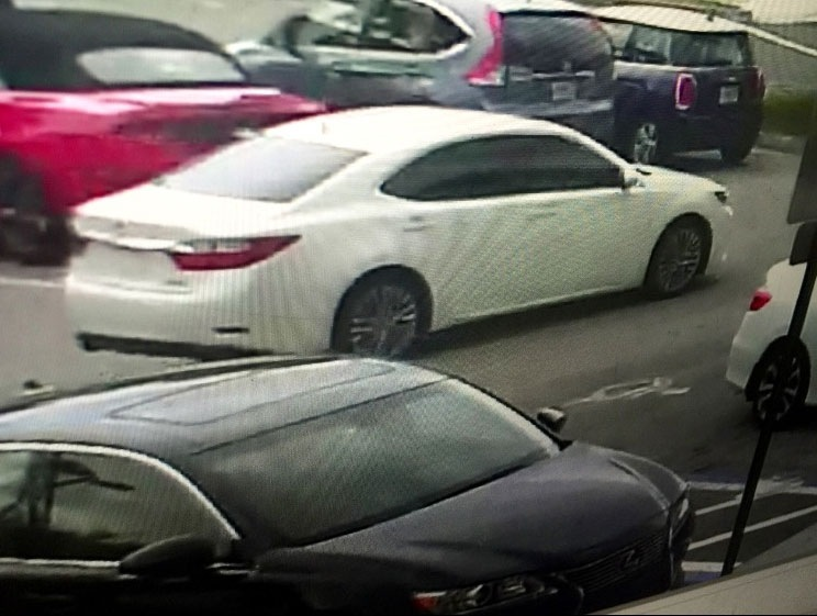 White, four-door Lexus used in the robbery of a Garda armored car making a courier stop in front of the American Signature Furniture store at the Sawgrass Mills Mall at 12801 W Sunrise Blvd. on August 2, 2016.