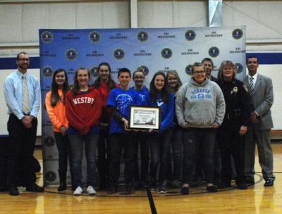 Eighth-grade students from Martin Luther School display FBI-SOS certificate with FBI and Oshkosh Police representatives.