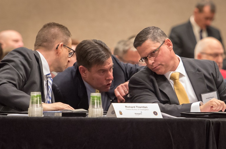 FBI officials Joe Rivers, Mike Hartnett, and Richard Thornton take part in a security exercise December 6, 2017, in Minneapolis.