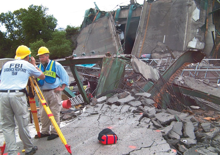 FBI Evidence Response Team members record damage to the I-35W bridge, which collapsed August 1, 2007 in Minneapolis. ERT members from the Minneapolis field office, as well as FBI offices in San Antonio, Pittsburgh, and Chicago, aided the federal probe, led by the National Transportation Safety Board.