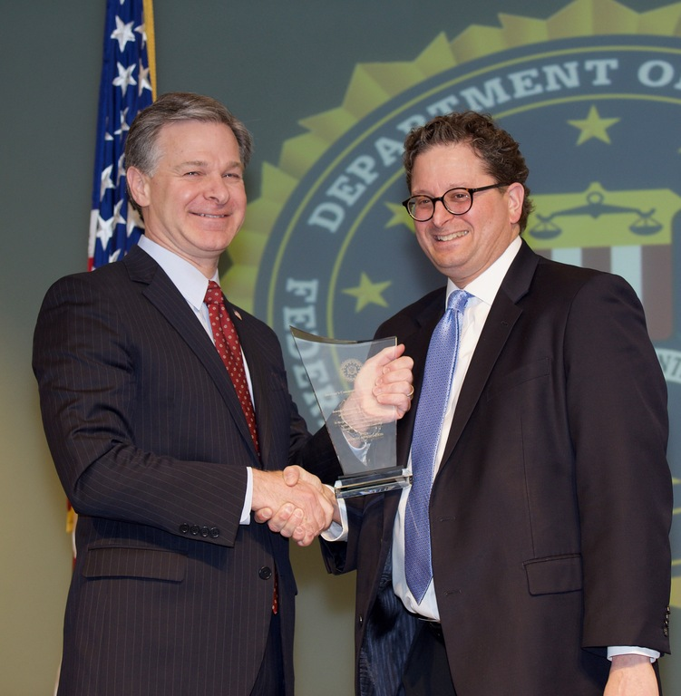 FBI Director Christopher Wray presents Minneapolis Division recipient the Jewish Community Relations Council of Minnesota and the Dakotas (represented by Steve Hunegs) with the Director's Community Leadership Award (DCLA) at a ceremony at FBI Headquarters on April 20, 2018.