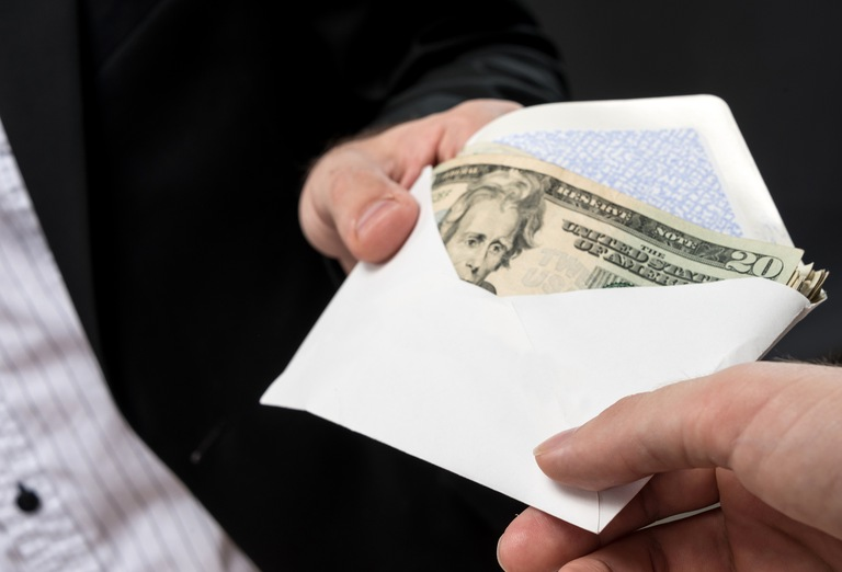 People Exchanging Envelope Full of Money (Stock Image)