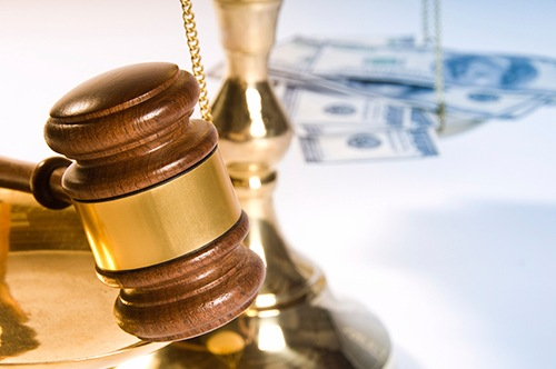 Gavel and Money on Scales of Justice