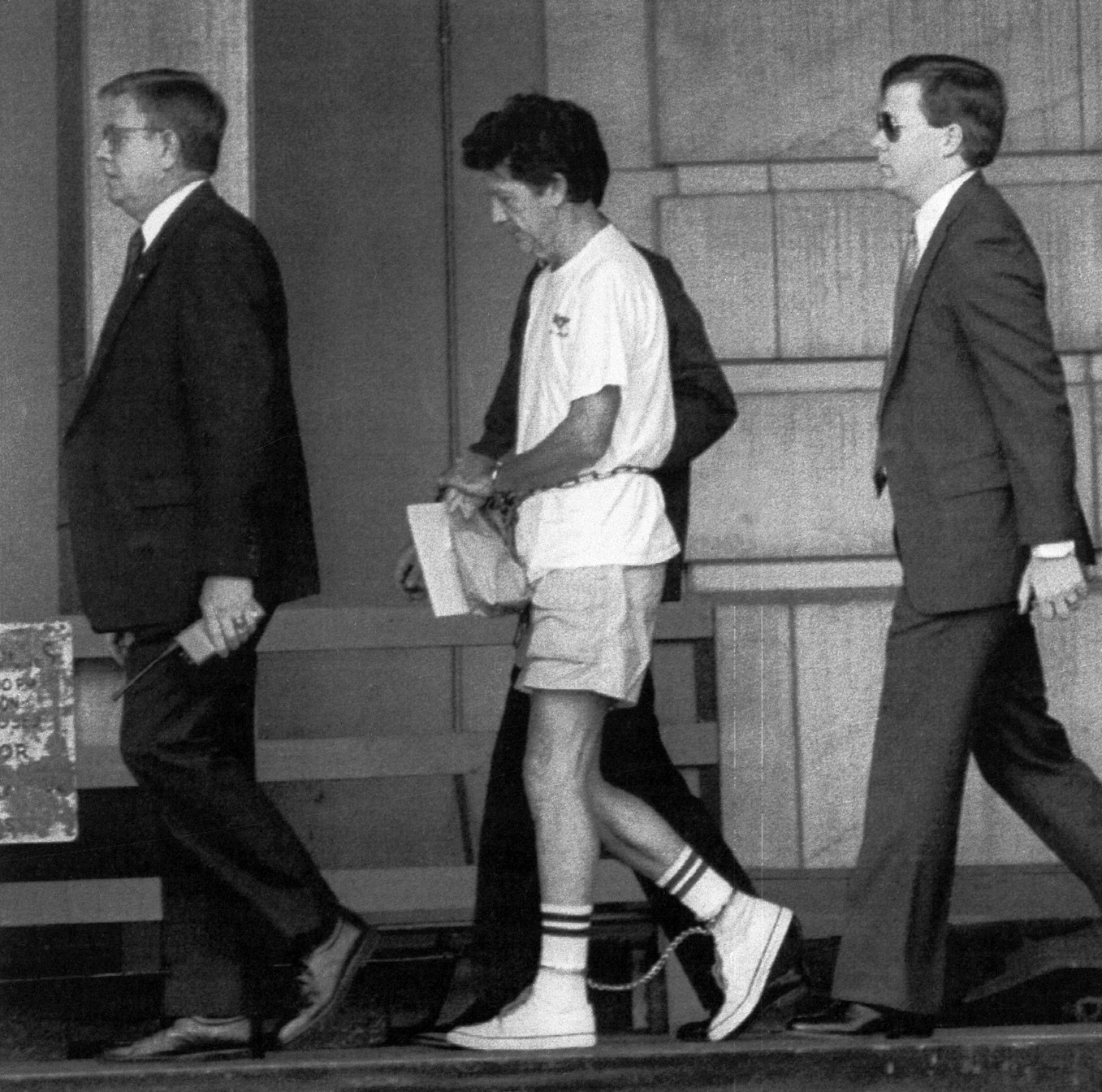 Walter Moody (center) is led into a federal courthouse in Macon, Georgia, during a hearing in 1990. Moody was convicted of killing Judge Robert Vance.