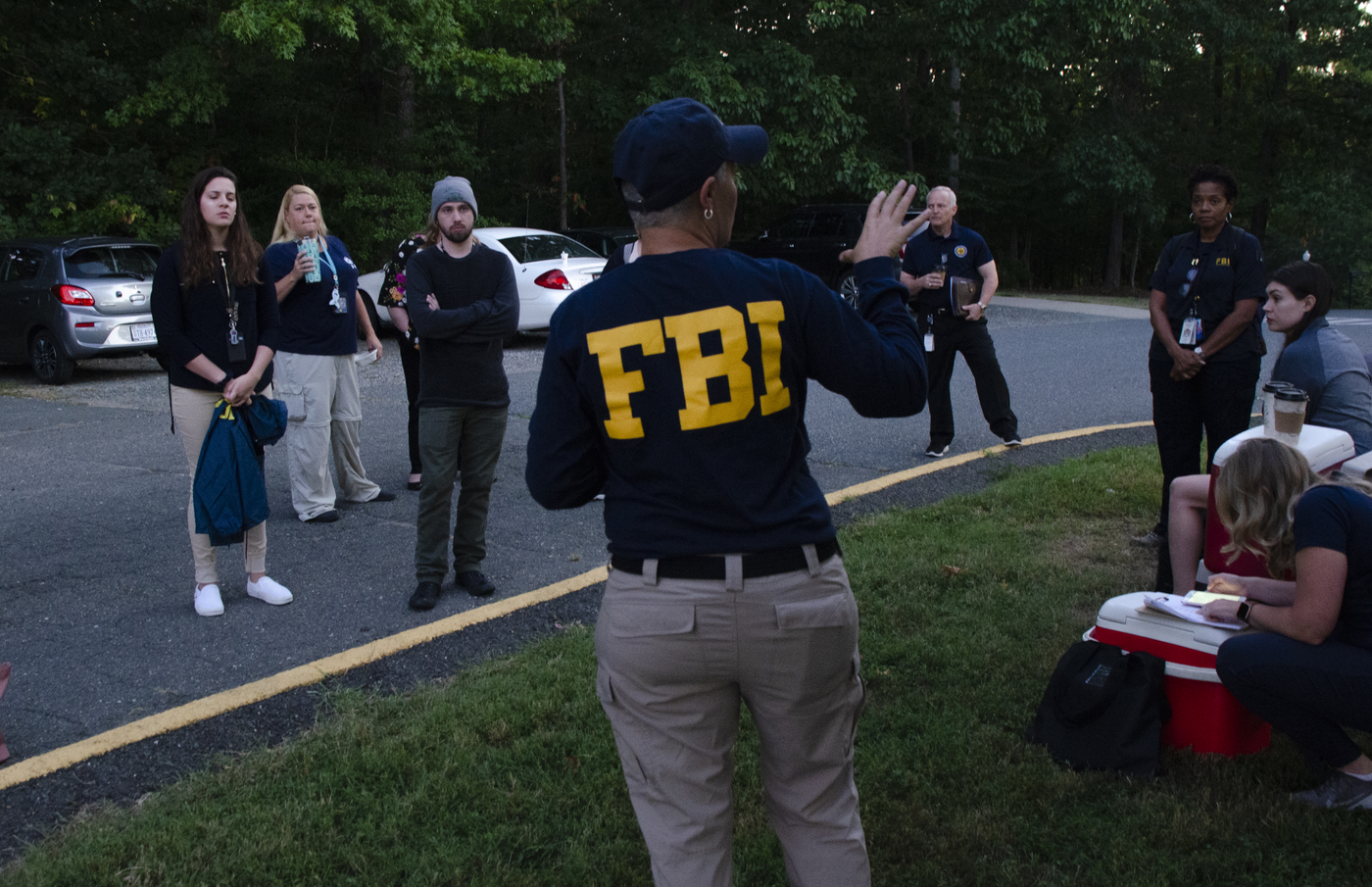 Rebecca Elam, a Victim Services Division program manager, conducts an early-morning briefing for role-players and colleagues ahead of a September 25, 2019, mass-casualty exercise at the FBI Training Academy in Quantico, Virginia. The exercise culminated ELEVATE-APB training for victim service providers.