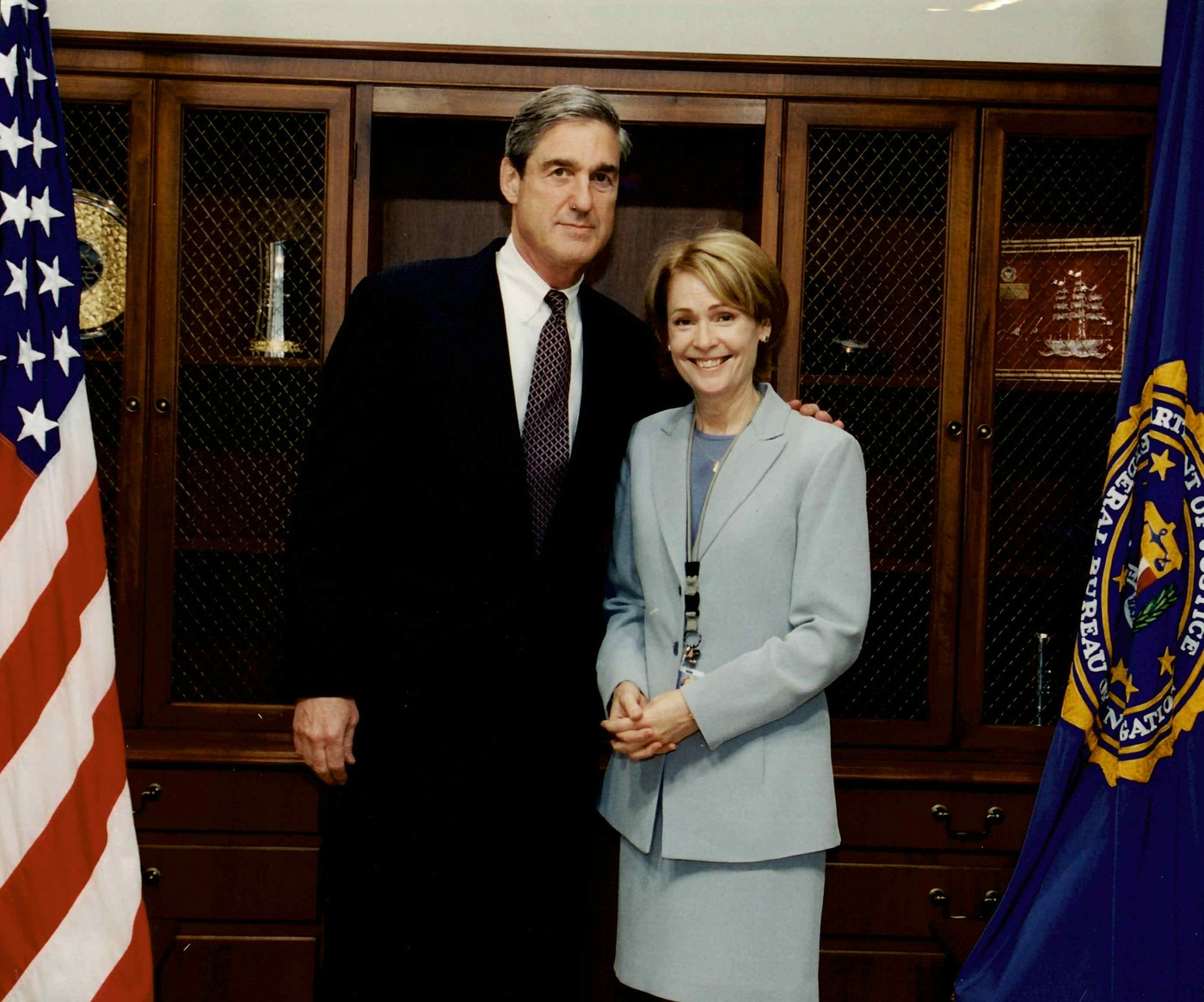 Kathryn Turman stands for a picture with FBI Director Robert S. Mueller in 2002.