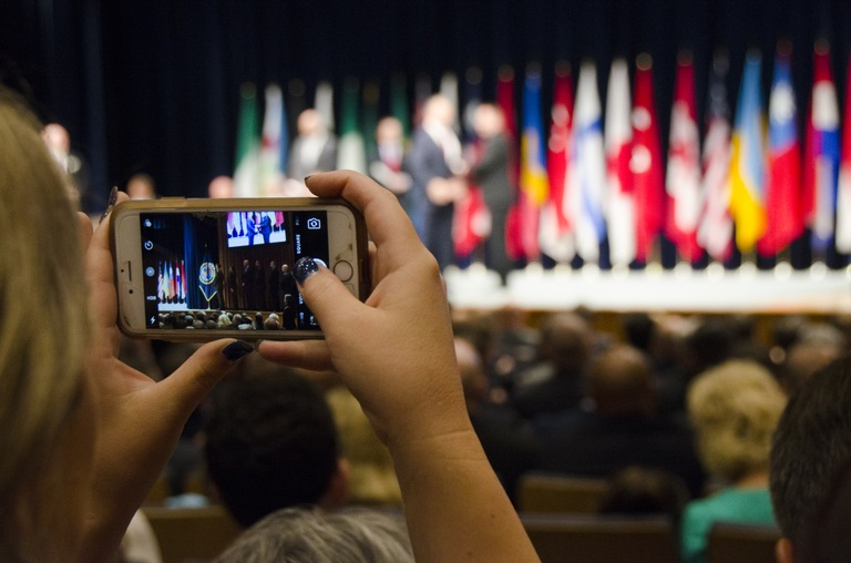 Audience Member at National Academy Graduation Takes a Picture