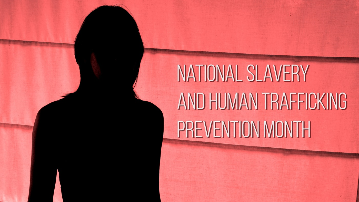 Stock image depicting a silhouetted woman against a red background with National Slavery and Human Trafficking Prevention Month text overlay.
