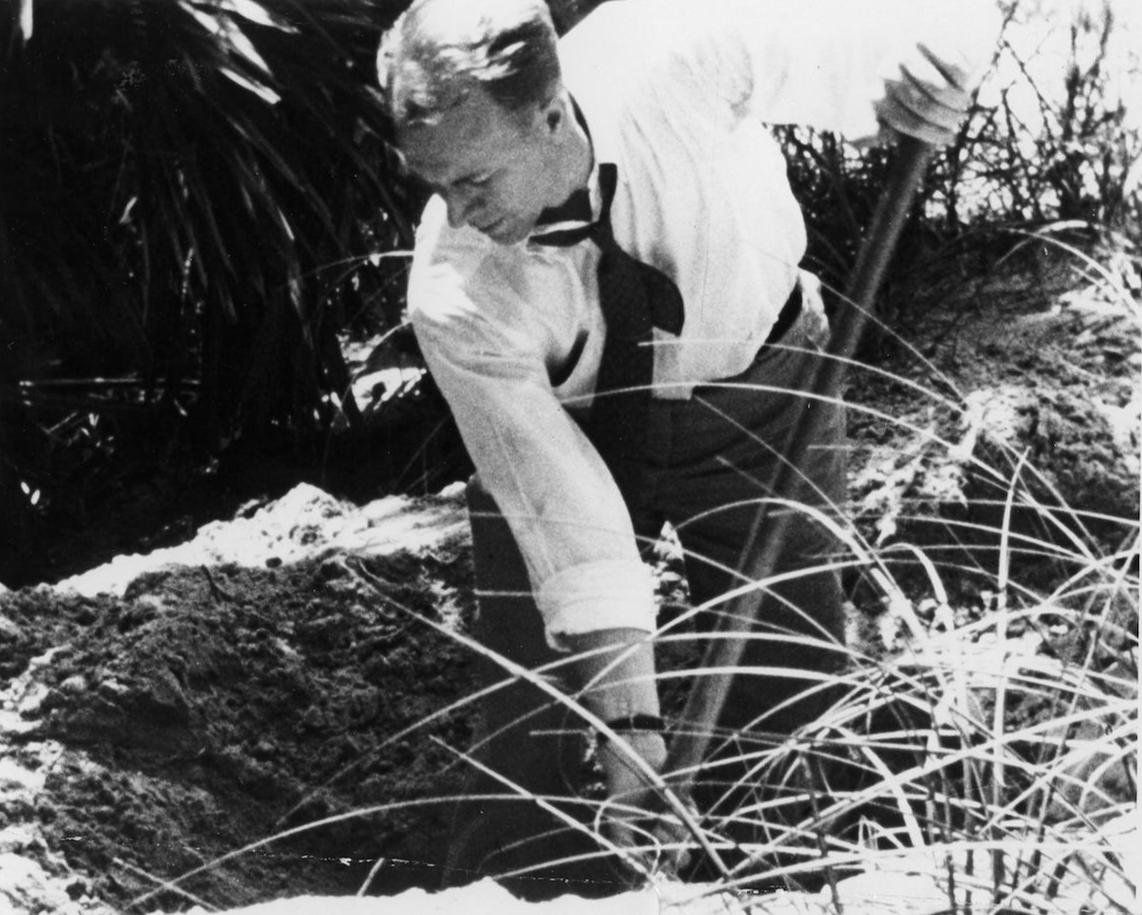 Special agent digs at spot in Ponte Vedra, Florida, where Nazi saboteur Kerling identified the spot where his team had buried their sabotage equipment and uniforms in 1942.