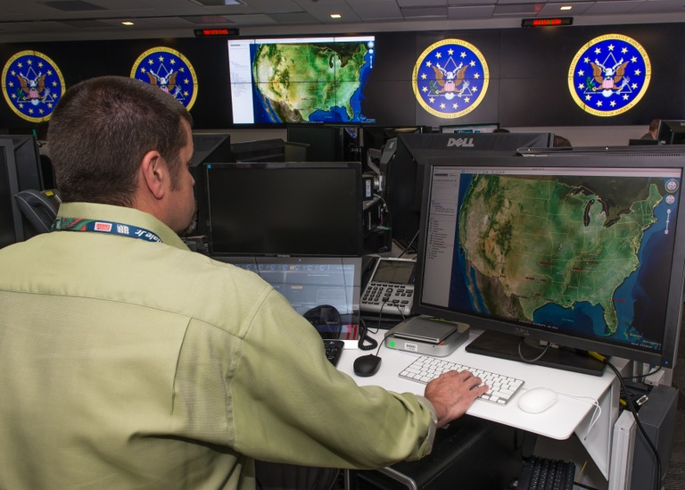 A member of the National Cyber Investigative Joint Task Force (NCIJTF) at work. The NCIJTF is composed of nearly two dozen federal intelligence, military, and law enforcement agencies, along with local law enforcement and international and private industry partners. The task force serves as the government's central hub for coordinating, integrating, and sharing information related to cyber threat investigations.