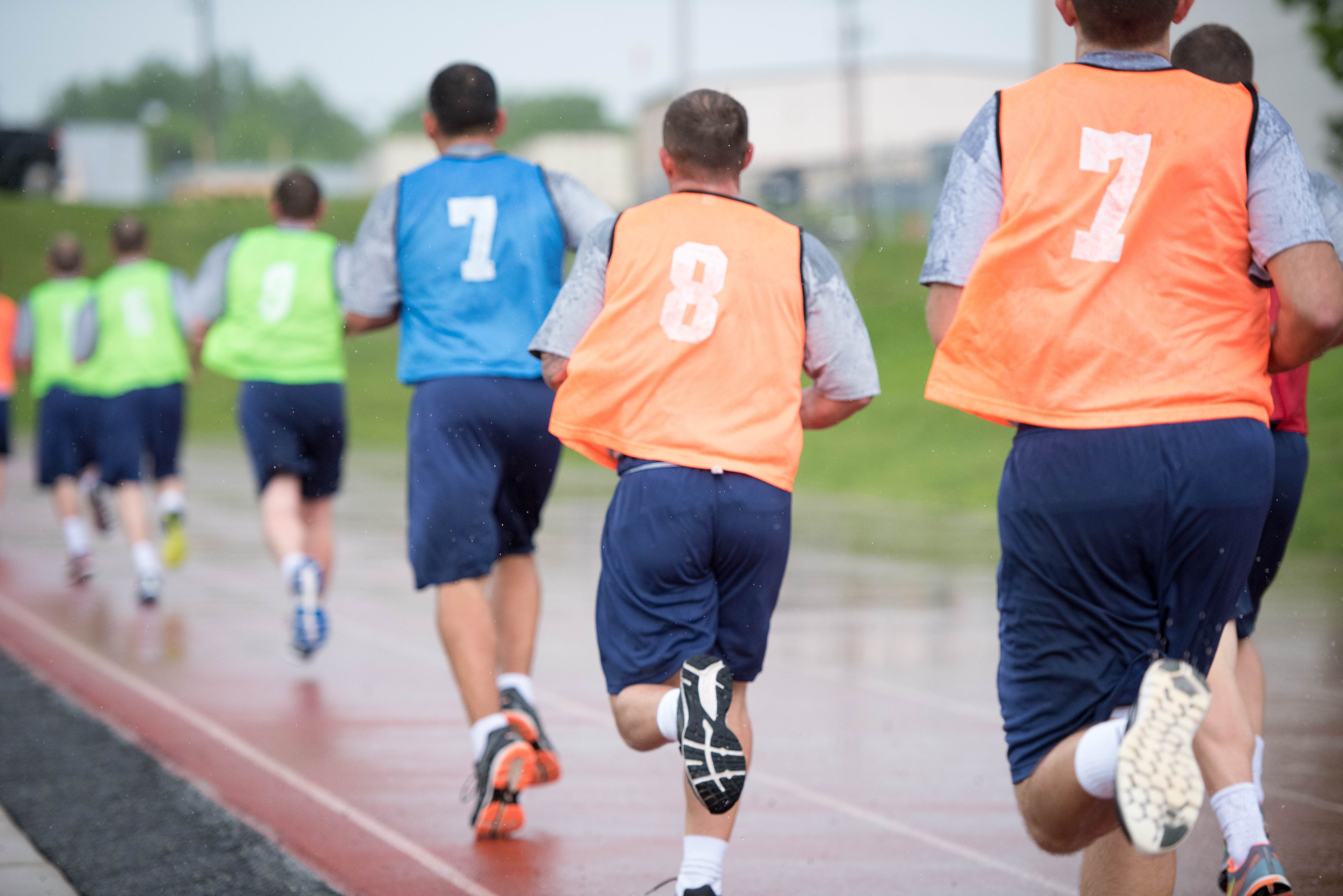 New agent trainees start their one-and-a-half-mile run in the rain as part of their physical fitness test (PFT) at the FBI Academy in Quantico, Virginia.