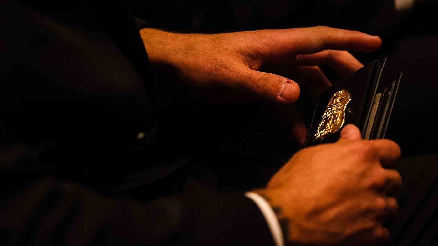 New Agent Holds Badge at FBI Academy Graduation