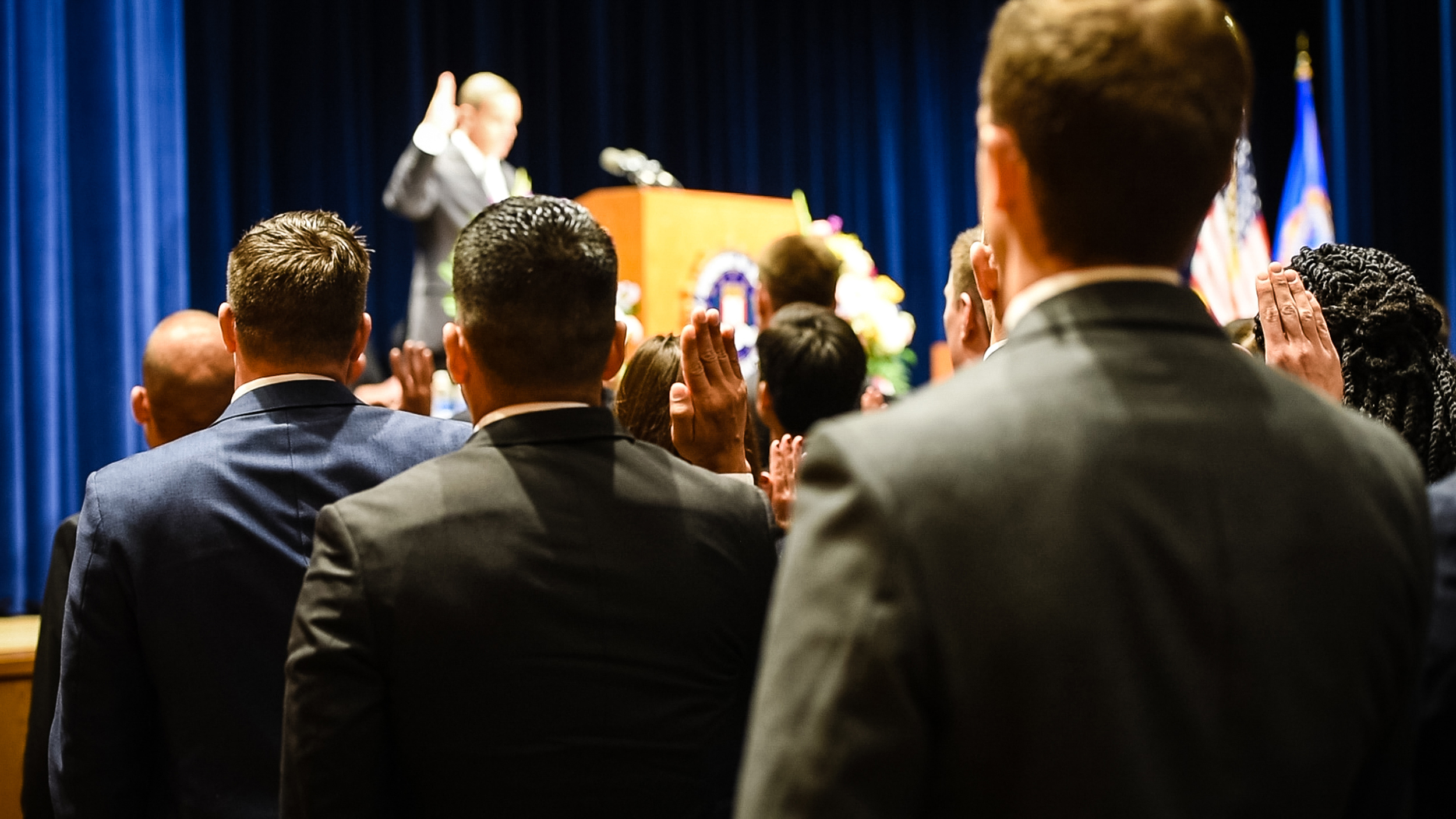 New Agents Take the Oath of Office at Graduation