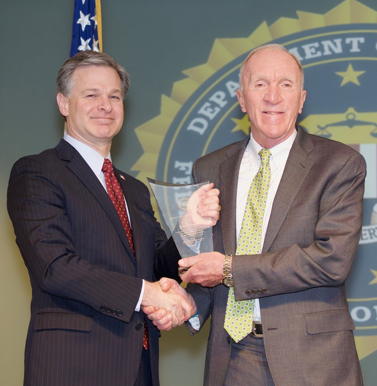 FBI Director Christopher Wray presents New Haven Division recipient Robert Pawloski with the Director's Community Leadership Award (DCLA) at a ceremony at FBI Headquarters on April 20, 2018.