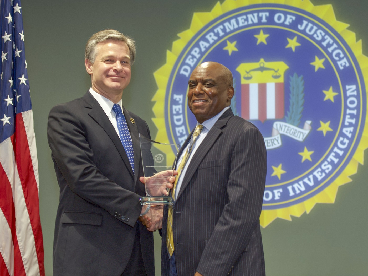 FBI Director Christopher Wray presents Newark Division recipient Perry Mays with the Director's Community Leadership Award (DCLA) at a ceremony at FBI Headquarters on May 3, 2019.