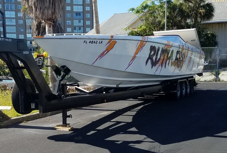 A white Cigarette racing boat with orange lightning bolts and the word Ruthless written on the side was among the assets seized from Nicholas Borgesano, Jr., in connection with his $100 million compounding pharmacy fraud scheme.
