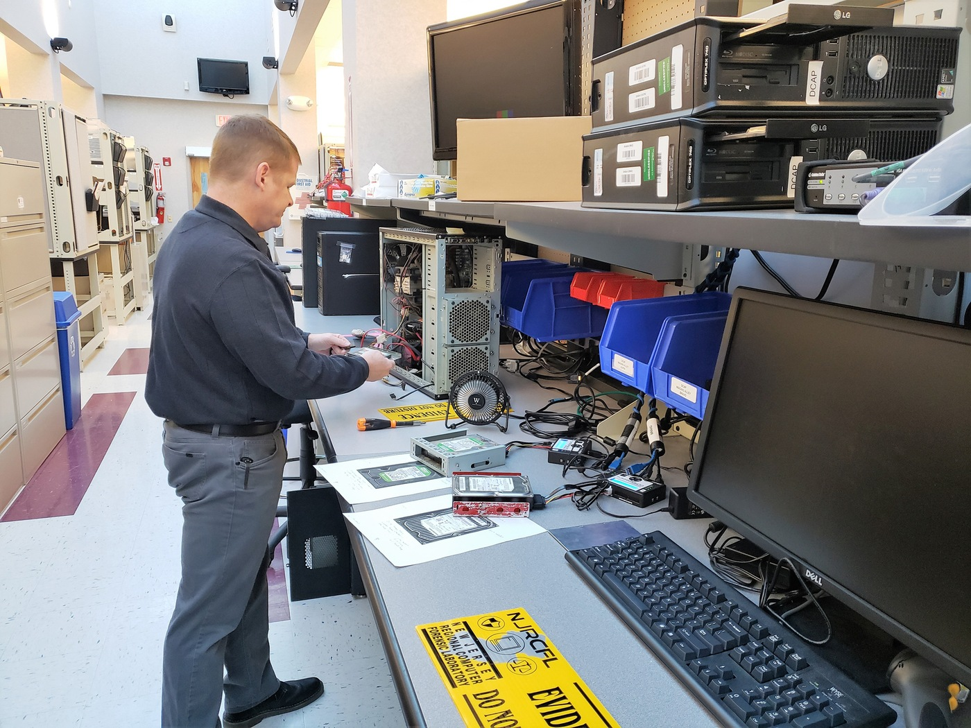 A digital forensics examiner works with evidence in the New Jersey Regional Computer Forensics Laboratory